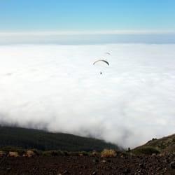 Paragliders above the clouds.