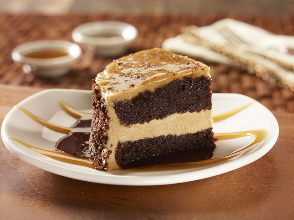 CAKE SWEET TREAT - Chocolate cake layered with butter cream, topped ...