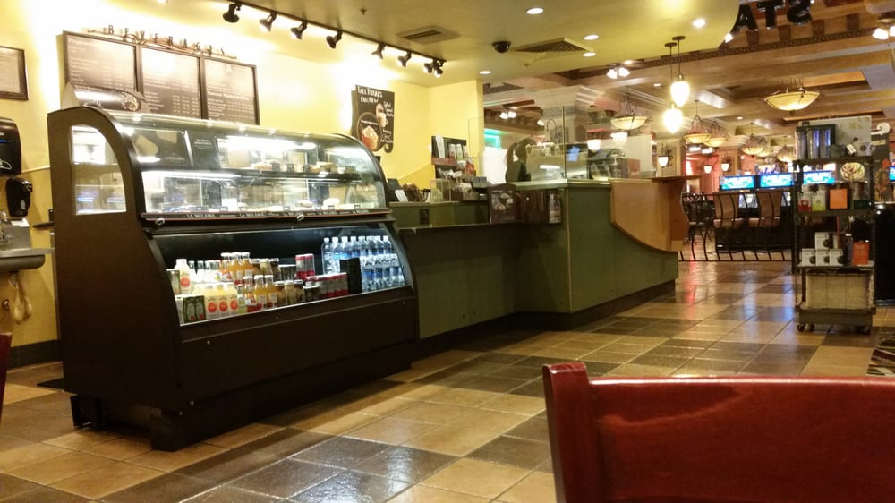The Starbucks Counter And Display Case At This Location