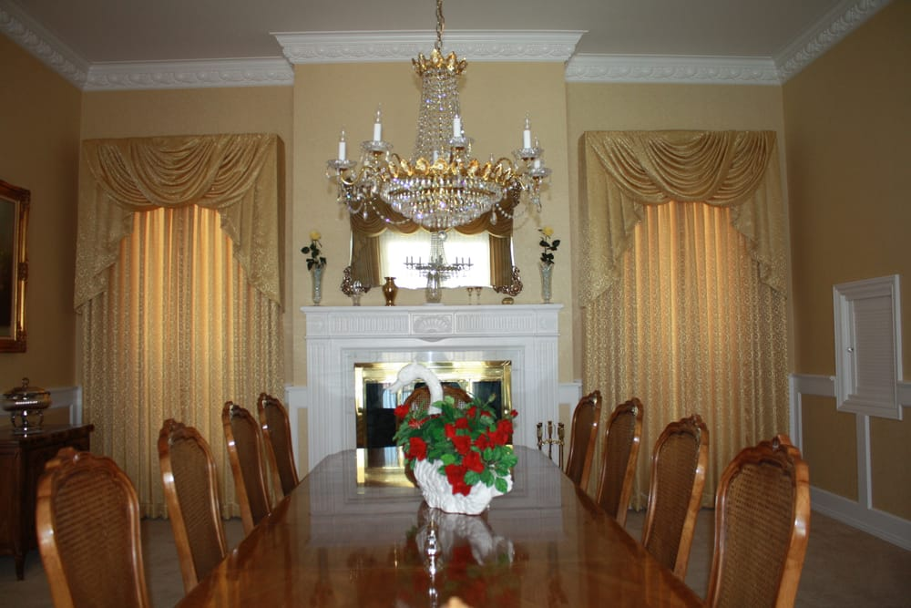 Updated elegant dining room with swags and cascade
