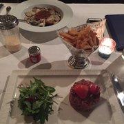 Restaurant La Villa - Marseille, France. Beef Tartare in foreground.  Ravioli in background.
