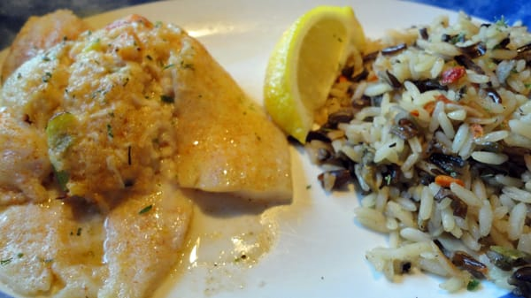 Seafood stuffed flounder with a rice pilaf | Yelp