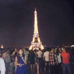 tourists oohing and aahing  over the incredible view of the Eiffel Tower!