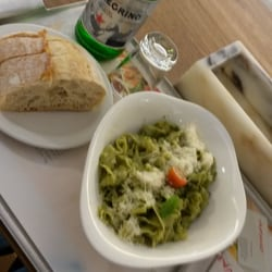 Pesto, bread and Pellagrino