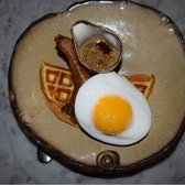 Signature duck & waffle with a duck egg and maple syrup