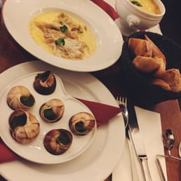 Escargot, foie gras ravioli in truffle cream sauce, & French onion soup