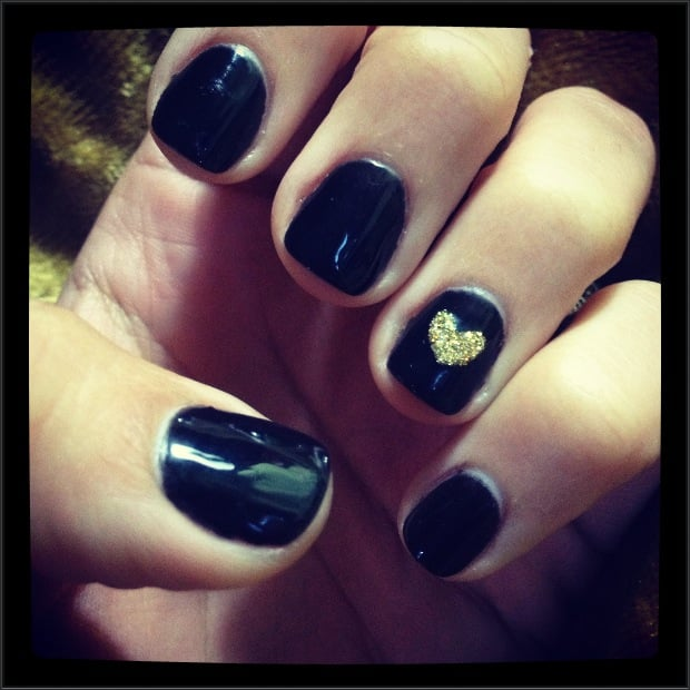 Gel manicure in black w gold glitter heart on each ring for 33 fingers salon