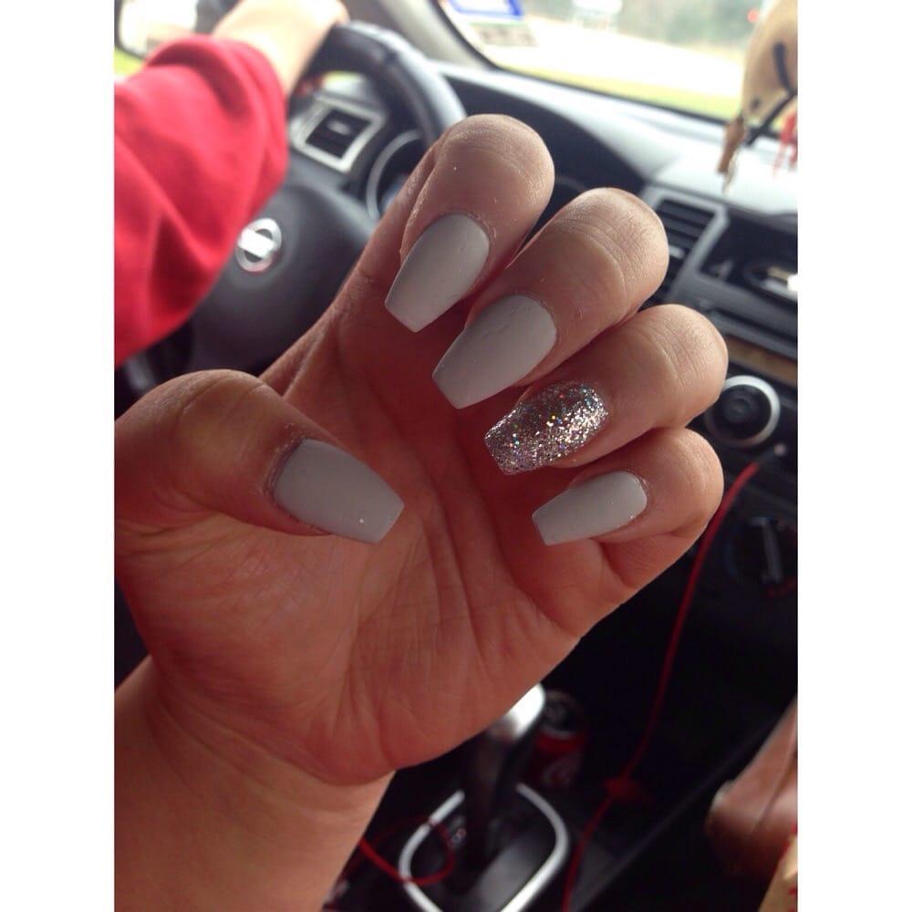 Matte grey coffin nails with a glitter accent i 39 m head for Euphoria nail salon