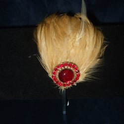 Hand made bespoke feather fascinator with vintage ruby red jewellery