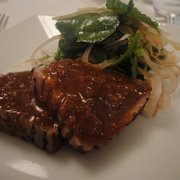 seared loin of yellow fin tuna with a sesame, soya and shallot dressing, coriander salad.
