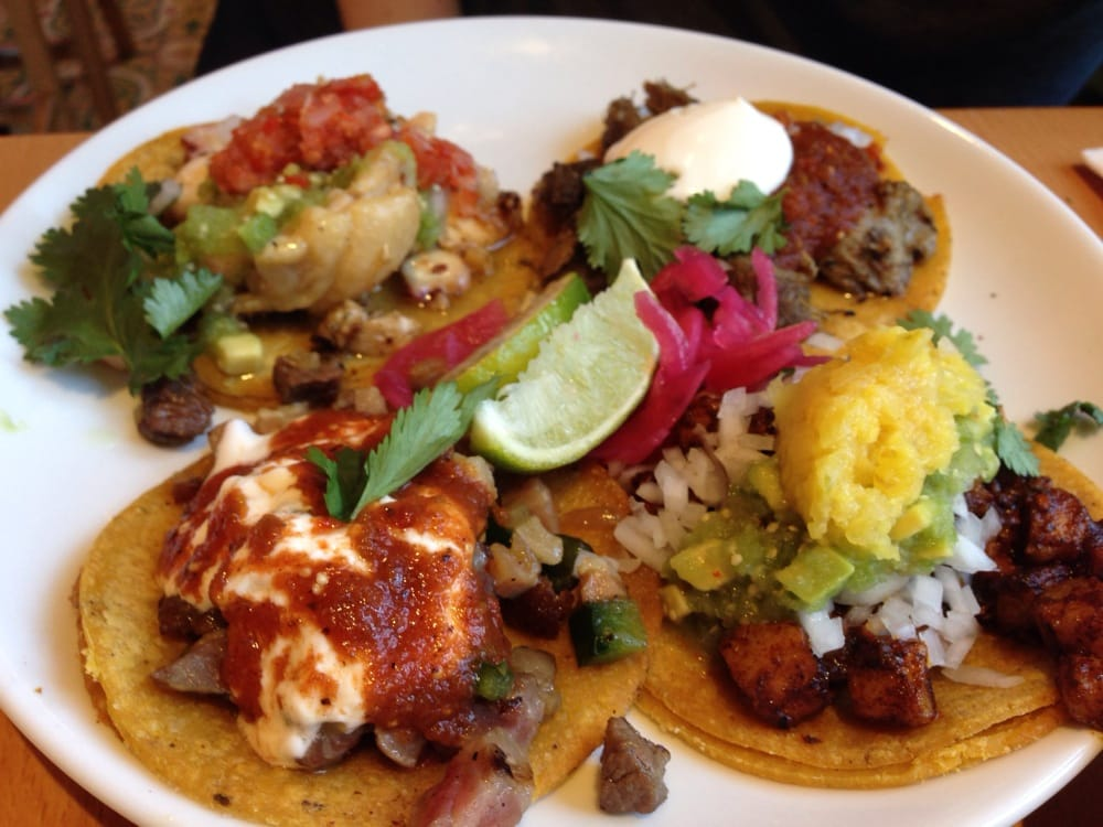 Chicken Wing Taco with Braised Octopus (top left), Al Pastor Taco with ...