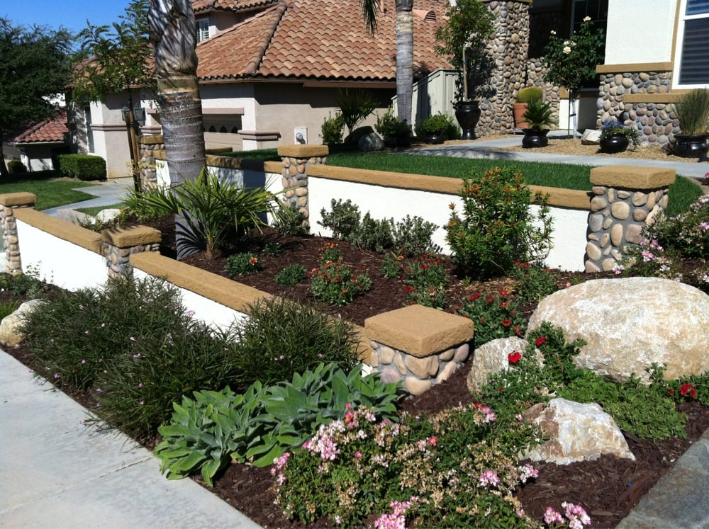 Terraced walls in front yard with custom caps and stone for Landscaping rocks temecula