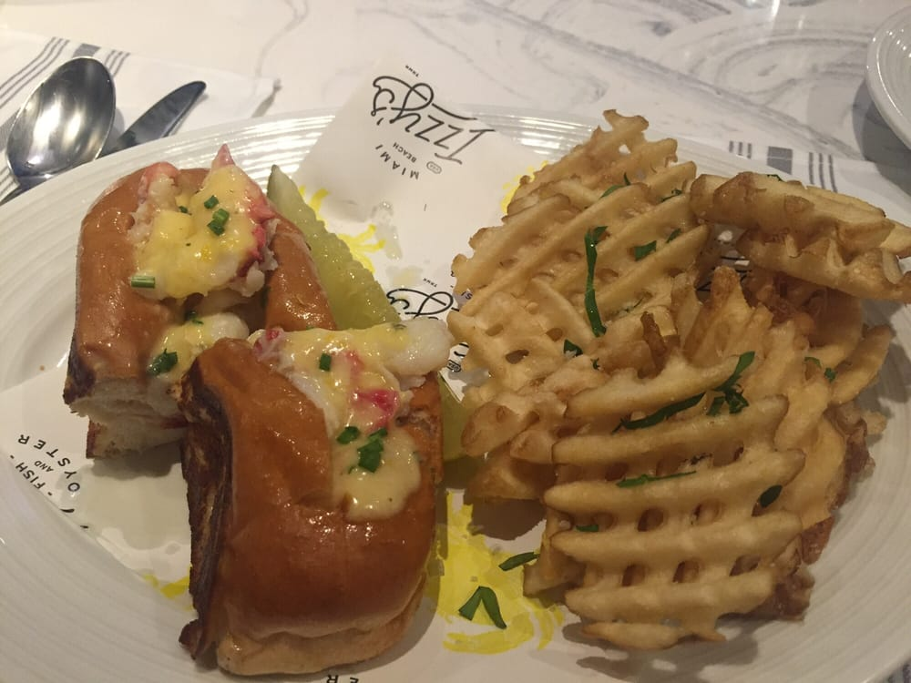 Lobster roll served warm with butter and topped with for Izzys fish and oyster