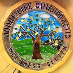 Moore Life Chiropractic Wellness Center logo