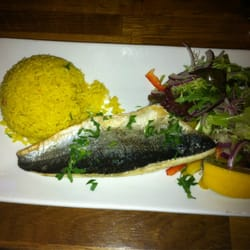 Seabass with rice and salad (far to…