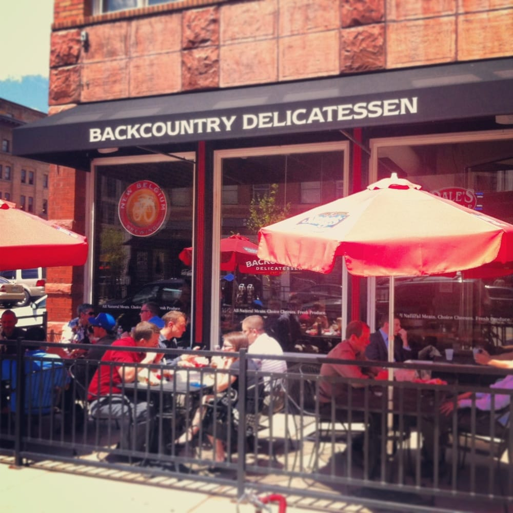 Backcountry Delicatessen - Denver, CO, United States. Packed patio on a sunny day