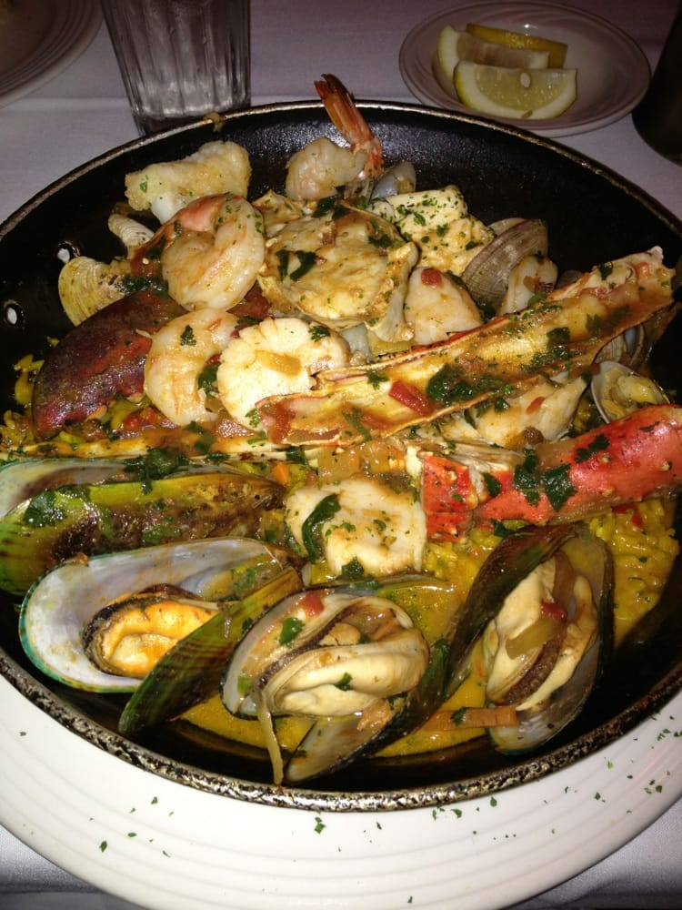 ... Paella with sea bass crab legs, lobster claw, shrimp, scallop, mussels