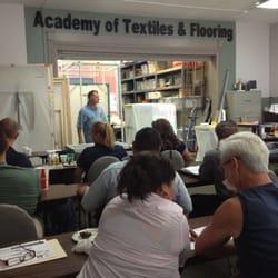Academy Of Textiles & Flooring logo