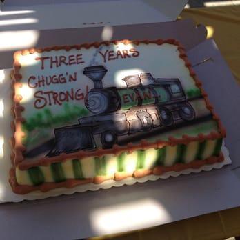 Evan's 3rd birthday cake - train theme (sorry about the shade; party was at the park).