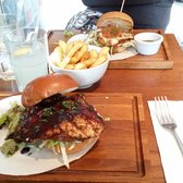 Gluten free burger in background.  Jerk chicken burger in front plus wet fries