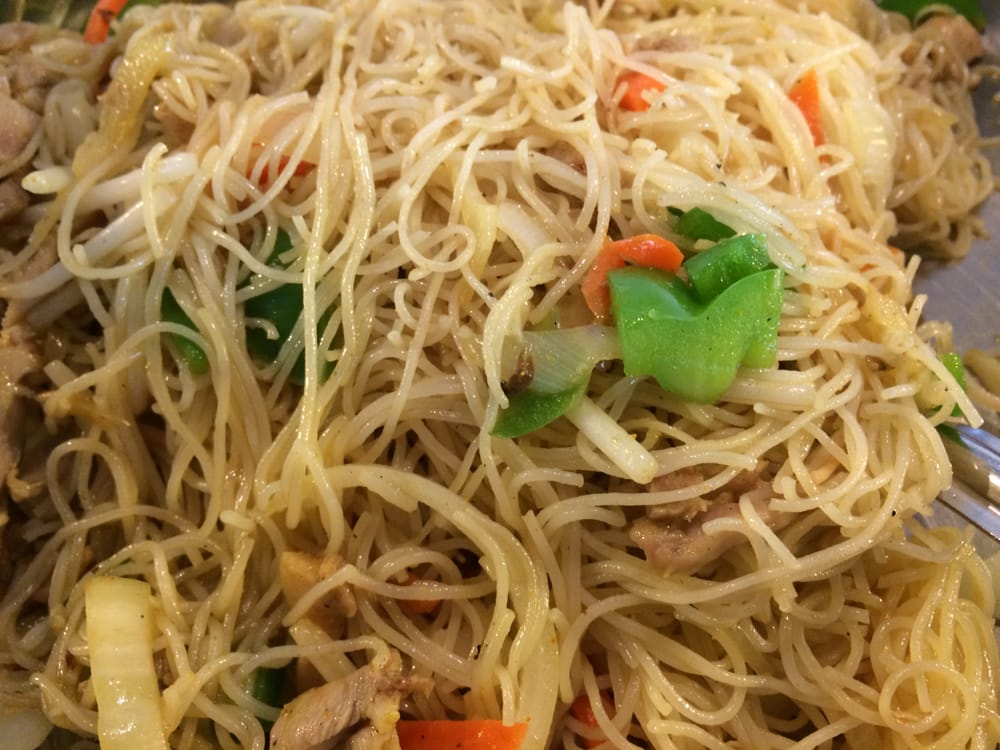 ... , IN, United States. Chinese rice noodles with vegetables and chicken