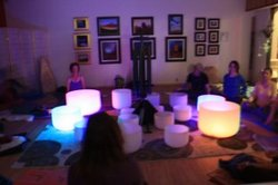 Dim ambiance as the only light comes from within quartz singing bowls