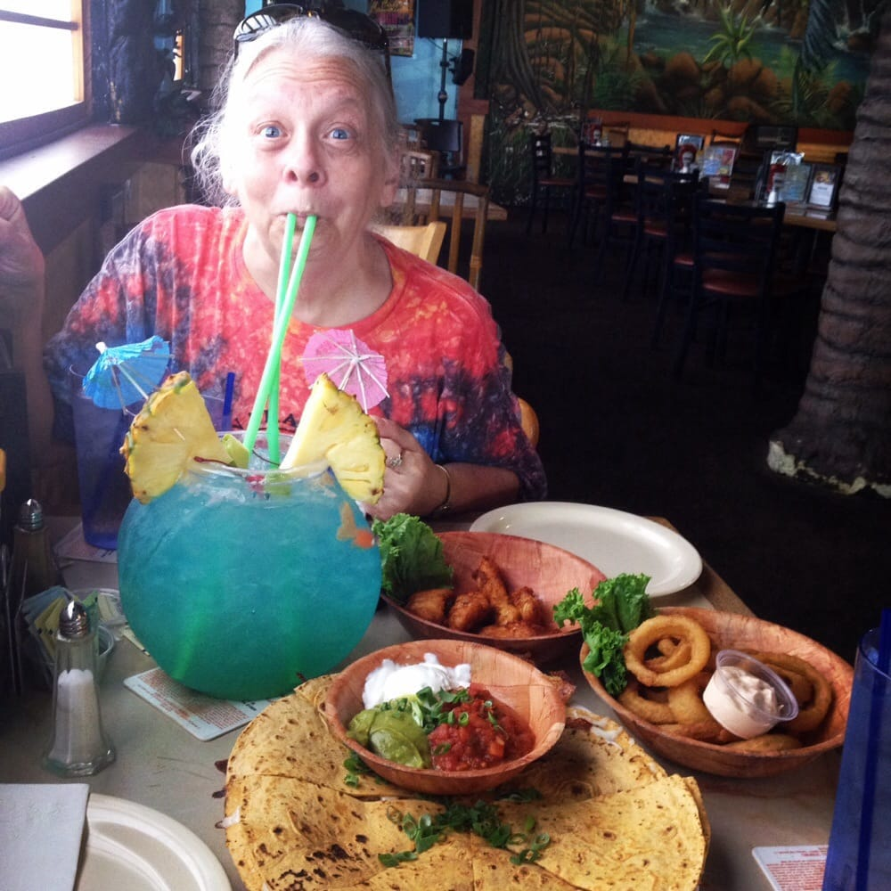 My mom on her 60th birthday enjoying happy hour specials for Big fish happy hour