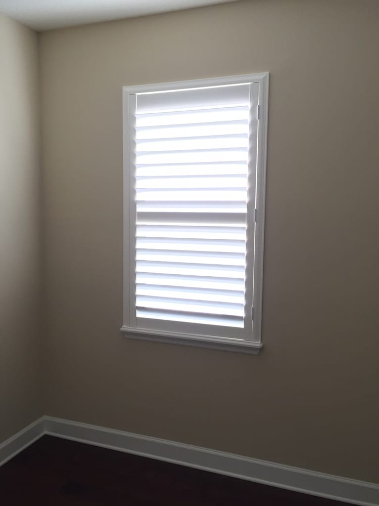 Plantation Shutters Installed Inside Of Window Sill For A