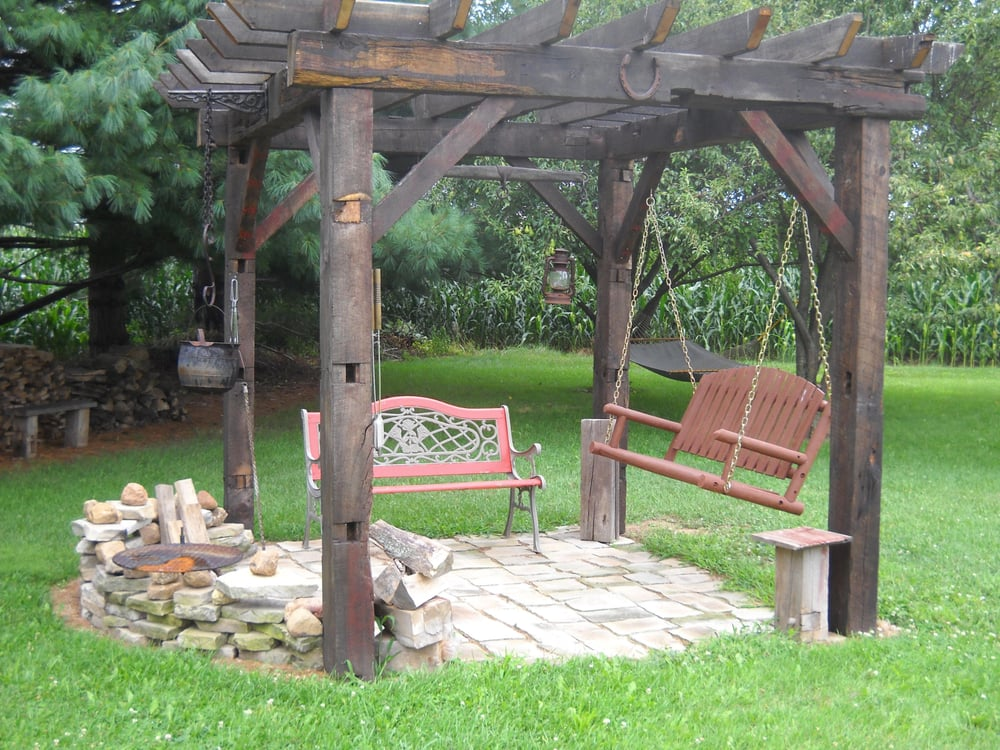 Old World Style Pergola With Firepit Seating And Cooking