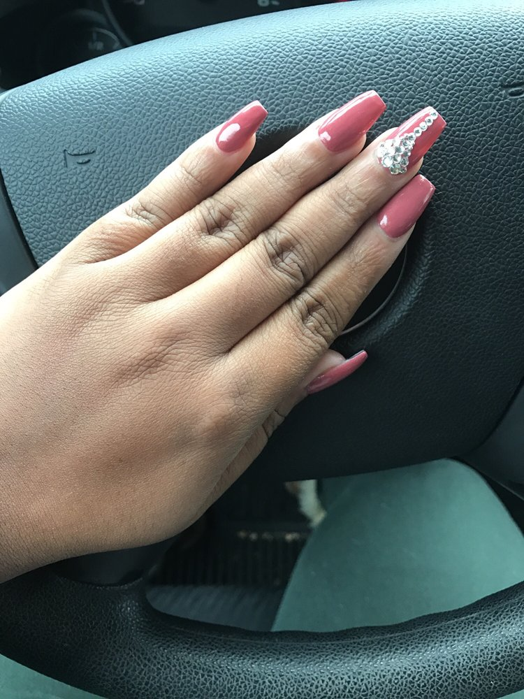 Mauve polish with acrylic nails and one design. The color looked ...