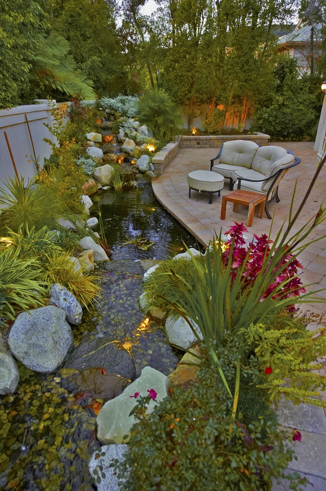 Pacific Outdoor Living : Waterfall and Pond with Paving Stone Patio - Yelp