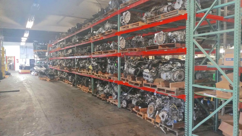 Racks Of Engines And Transmissions Stored Indoors At B R Auto