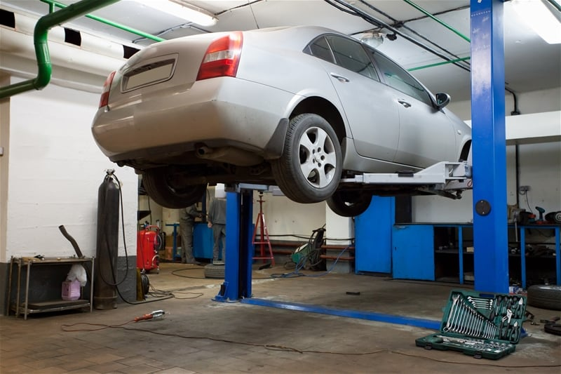 Clean And Professional Automotive Repair And Tire Shop Technician