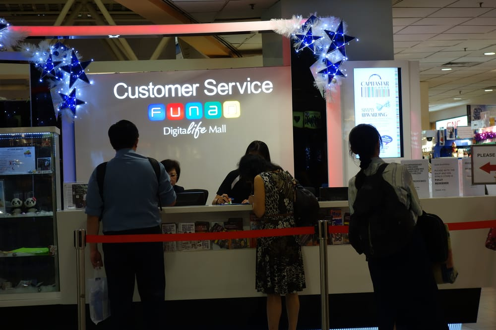 Customer Service Counter For Carpark Redemption And In House Lucky