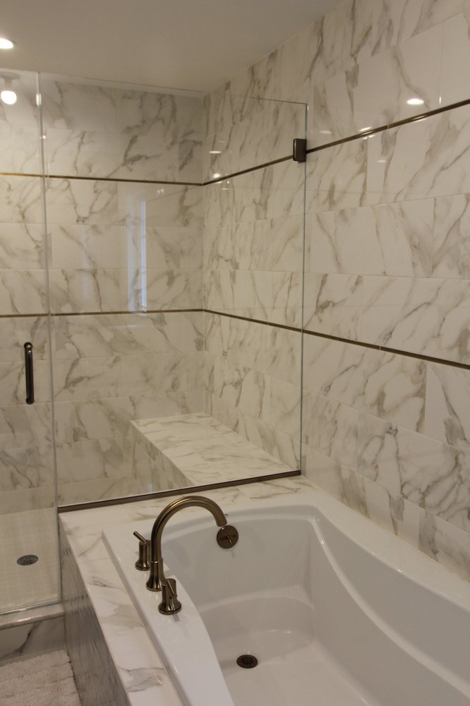 Master Bath Ceramic Marble Looking Tile With A Metalic Gold Accent