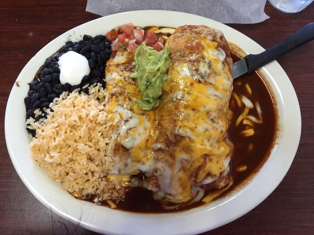 Combo plate with a chicken enchilada and a wet chile - Mexican american cuisine ...