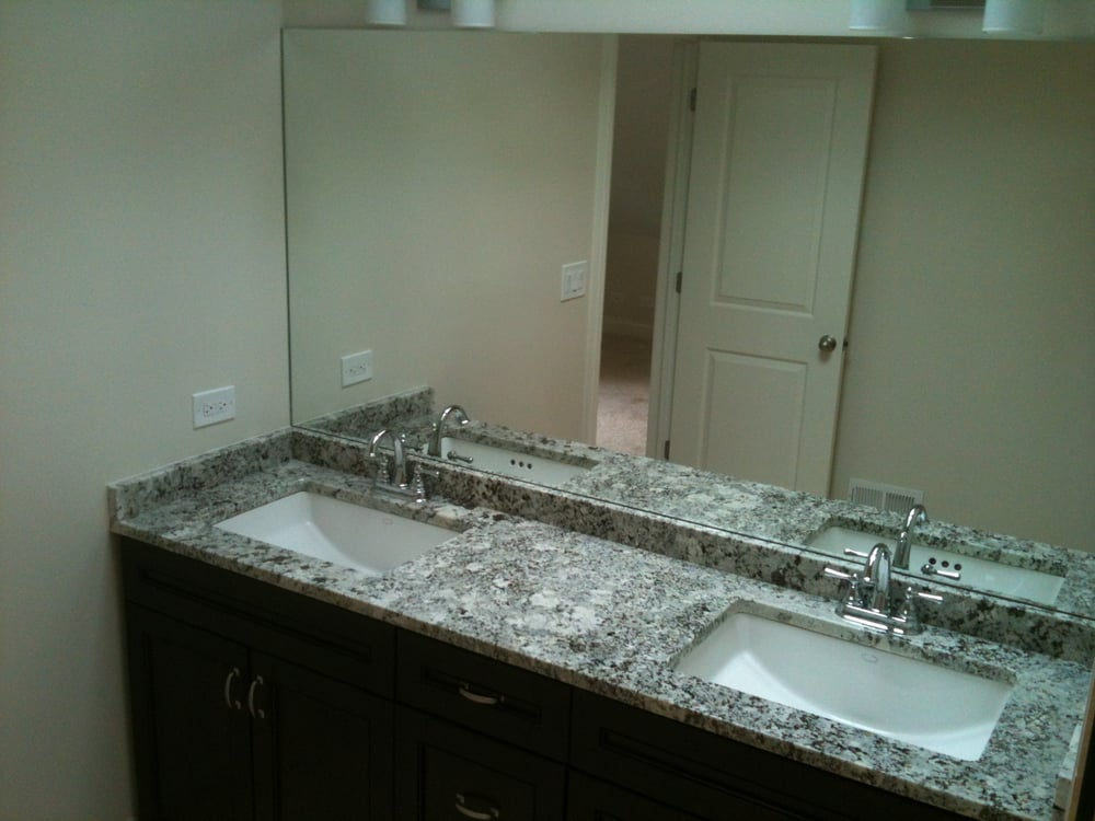 Newly finished master bath. Chocolate double vanity with ...