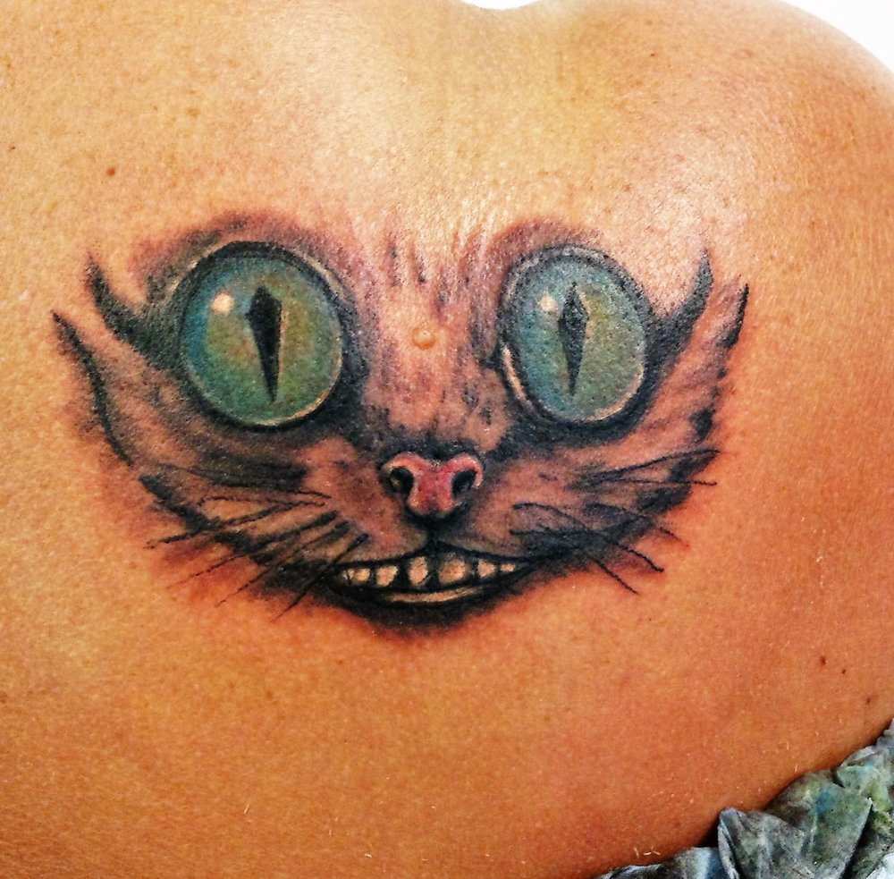 49894085ff88e Custom tattoo Cheshire Cat on the shoulder blade by Dave - Yelp
