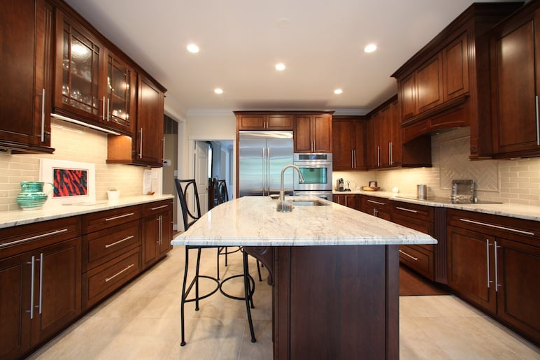 Luxury kitchen remodel with marble countertops stainless for Cherry kitchen cabinets with white appliances