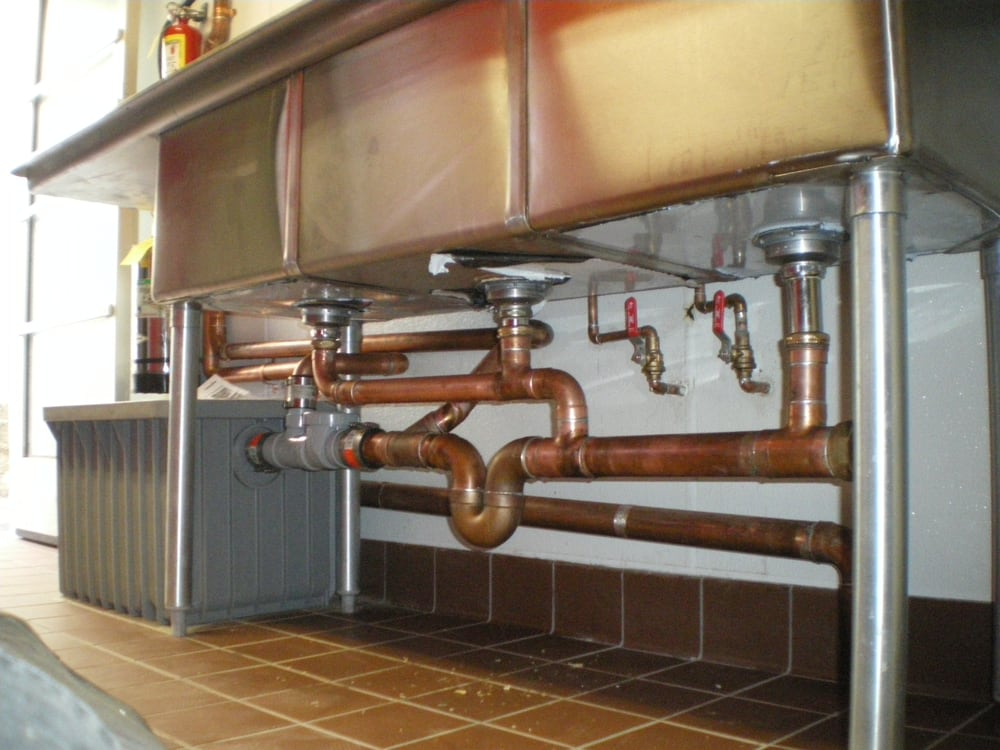 Commercial Plumbing Installation : Installed gallon grease trap commercial sink incoming out
