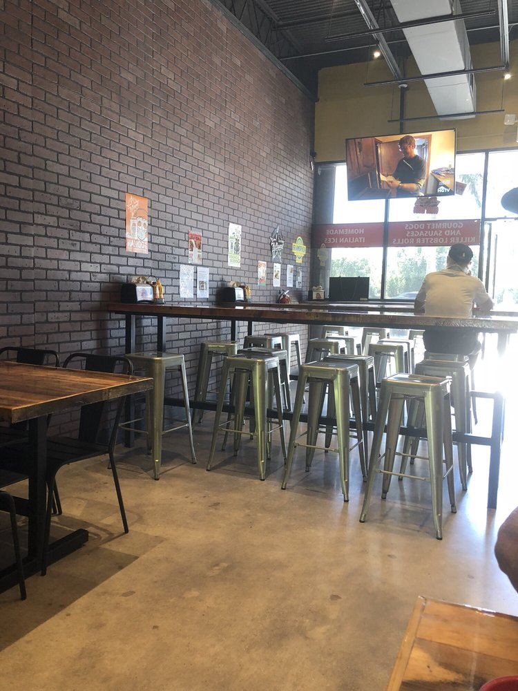High Top Tables And Front Window With Large Tv Yelp