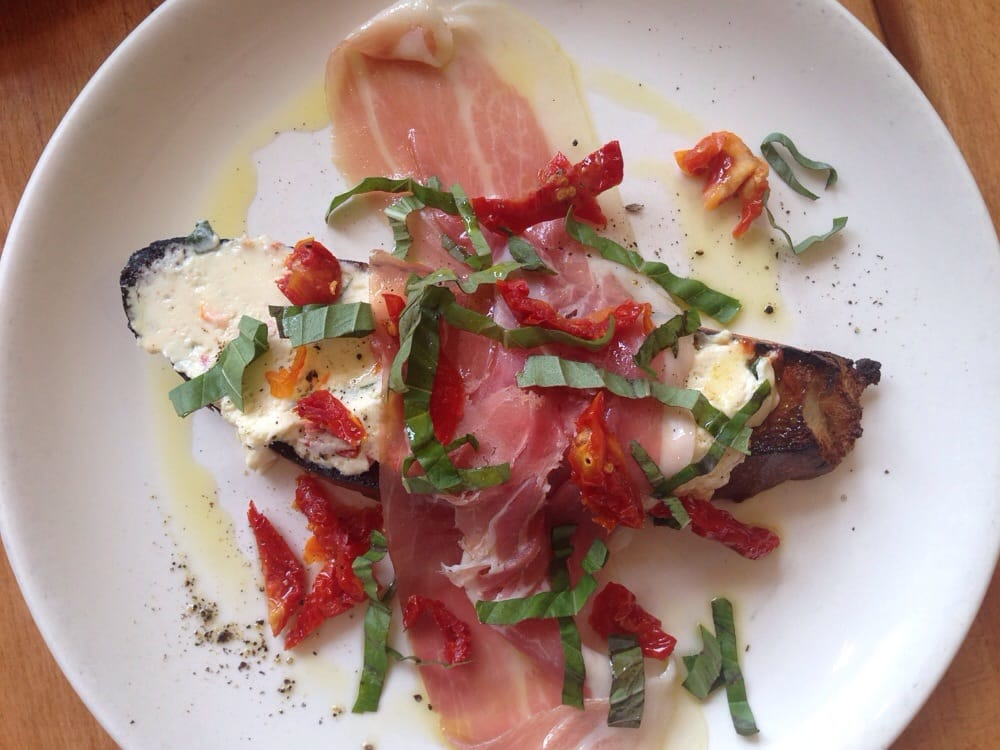 ... . Crostini with goat cheese, prosciutto, basil, and sundried tomatoes