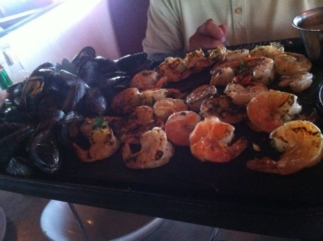 Large sizzling platter of mussels and shrimp the shrimp for The dead fish crockett