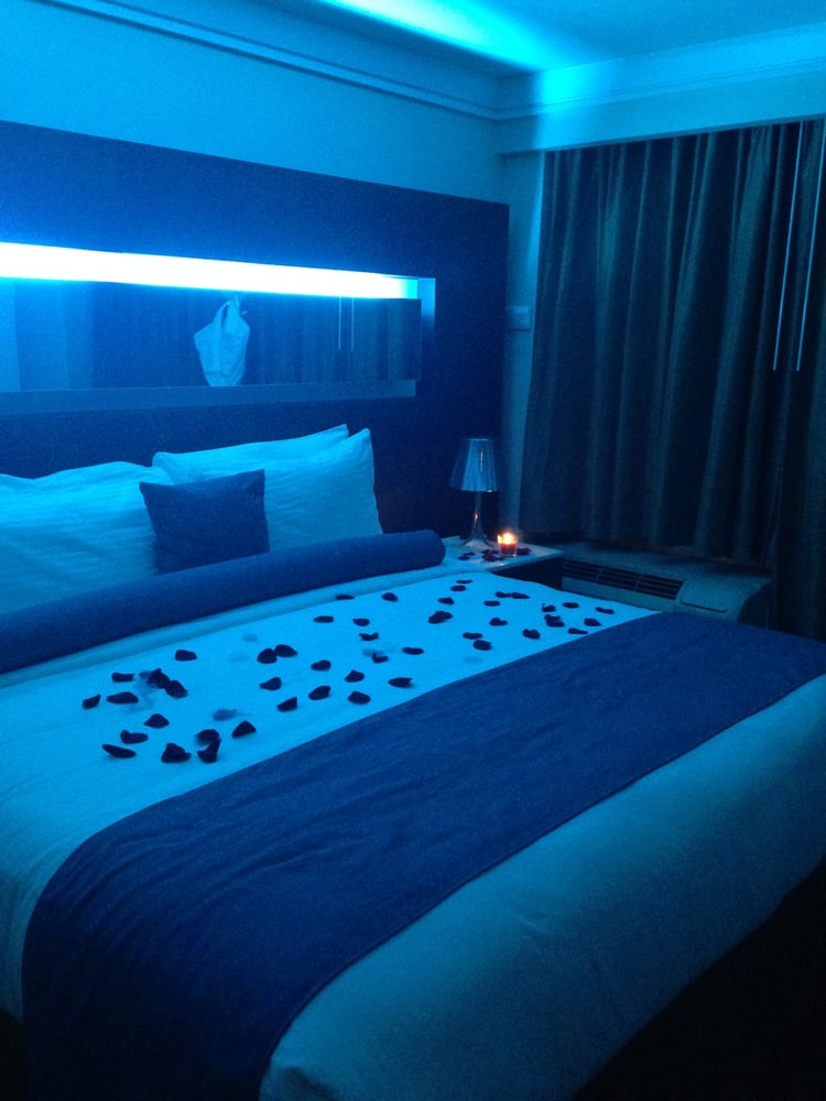 The King Size Bed In Our Room Blue Light Mirror Above