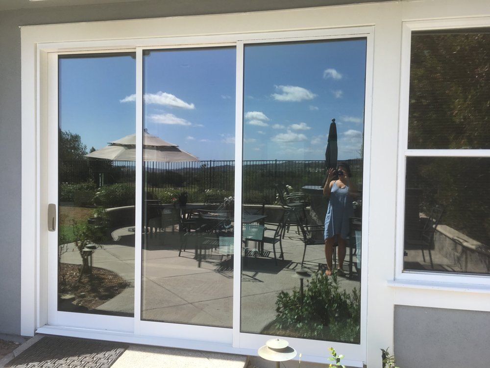 Replaced French Doors And Stationary Window With Triple Pane Slider