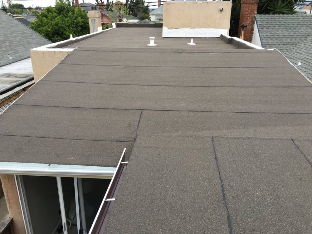Flat Roof With A Slope Roof Addition Yelp