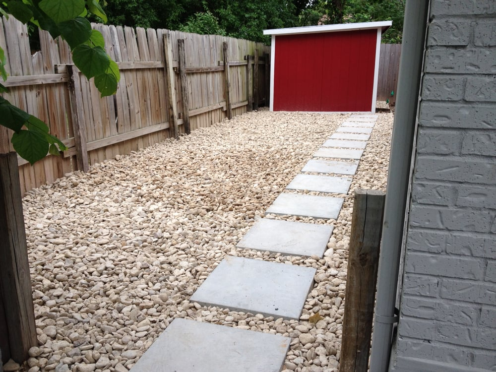 New river rock and pavers to the little red shed now have for Landscaping rocks austin