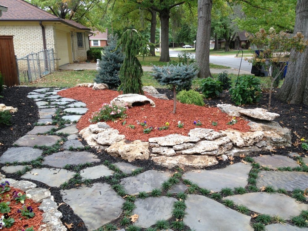 Raised Landscape Bed With Limestone Boulder Border And