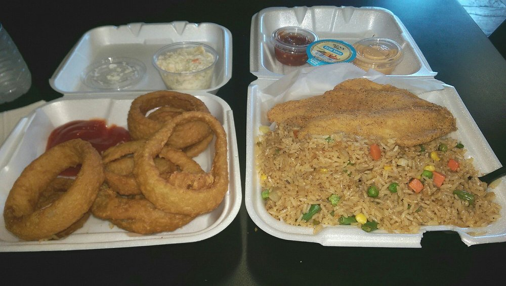 Fried tilapia fried rice onion rings and coleslaw the for Best fried fish near me