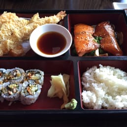 Bada Sushi - Suffern, NY, United States. Lunch Salmon Teriyaki Bento Box - comes with tempura, shumai, and a classic roll (pictured: eel roll).